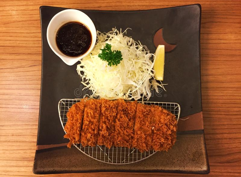 Fried pork set on the wooden table. With nice decoration royalty free stock photo