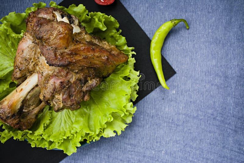 Fried pork shank with salad stock photos