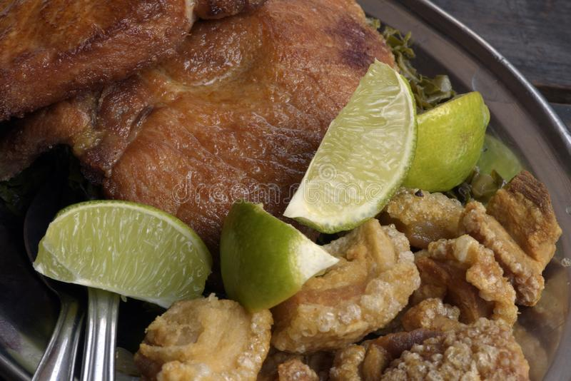 Fried pork steak and crackers, side dishes of feijoada royalty free stock photo