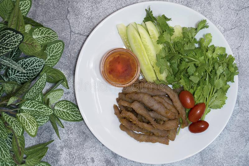 Fried Pork with sweet chilli sauce and fresh vegetable dish on c royalty free stock image