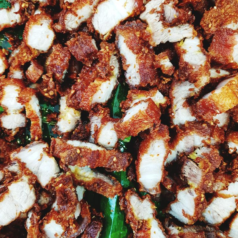 Fried pork Thai food recipe. Meal, meat, cooking, kitchen, chef, dinner, thai-food, fried-pork stock photo