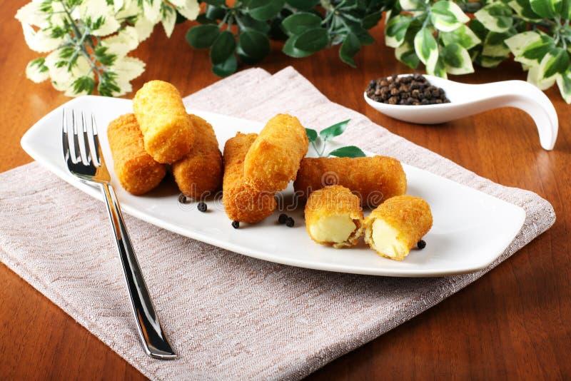 Fried potato croquettes royalty free stock photo