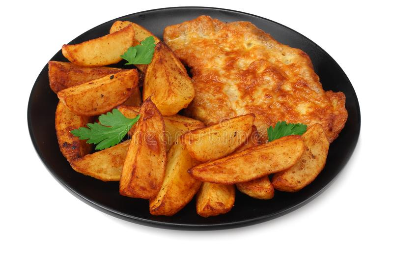 Fried potato wedges with schnitzel on black plate isolated on white background stock photos