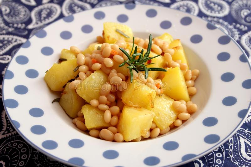 Fried potatoes with beans stock images