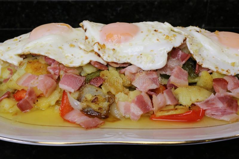 Fried potatoes with egg and bacon royalty free stock photography