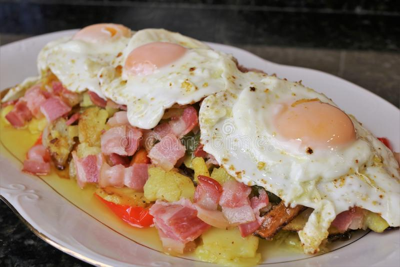 Fried potatoes with egg and bacon royalty free stock photo