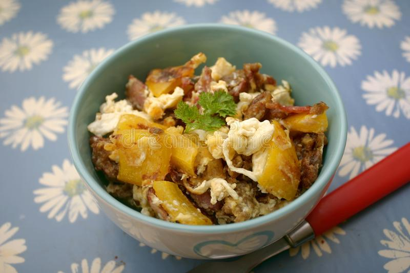Fried potatoes with eggs stock images