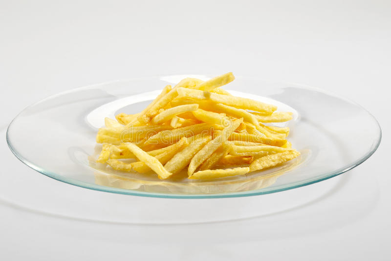 Fried potatoes on the plate stock image