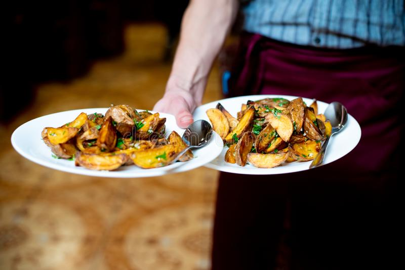 fried potatoes on a platter stock photography