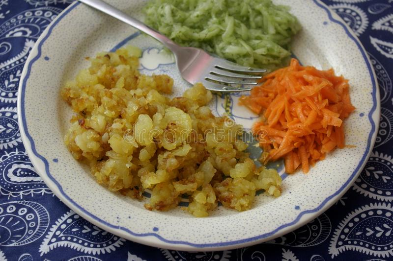 Fried potatoes with salad royalty free stock photos