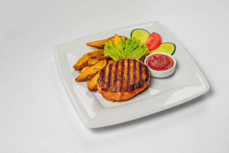 Fried potatoes with steak. Studio photo stock photography