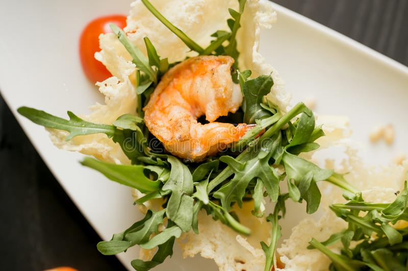 Fried prown with herbs on the table. Dish with raw shrims, herbs and tomatoes royalty free stock photo