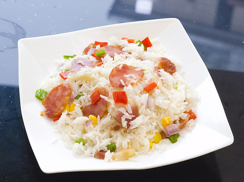 Fried rice. Vegetable fried rice sausage in skillet stock photo