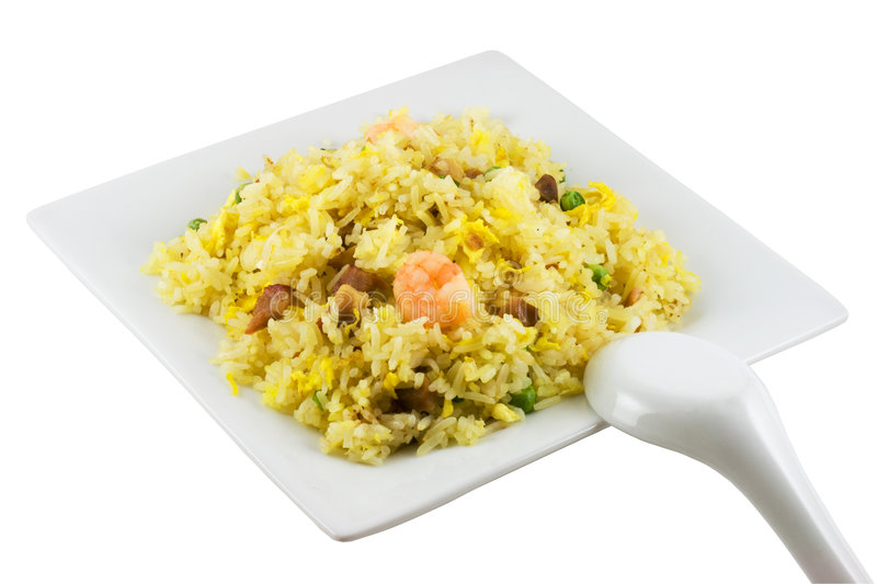 Fried Rice. A plate of fried rice and spoon isolated in solid white background stock photo