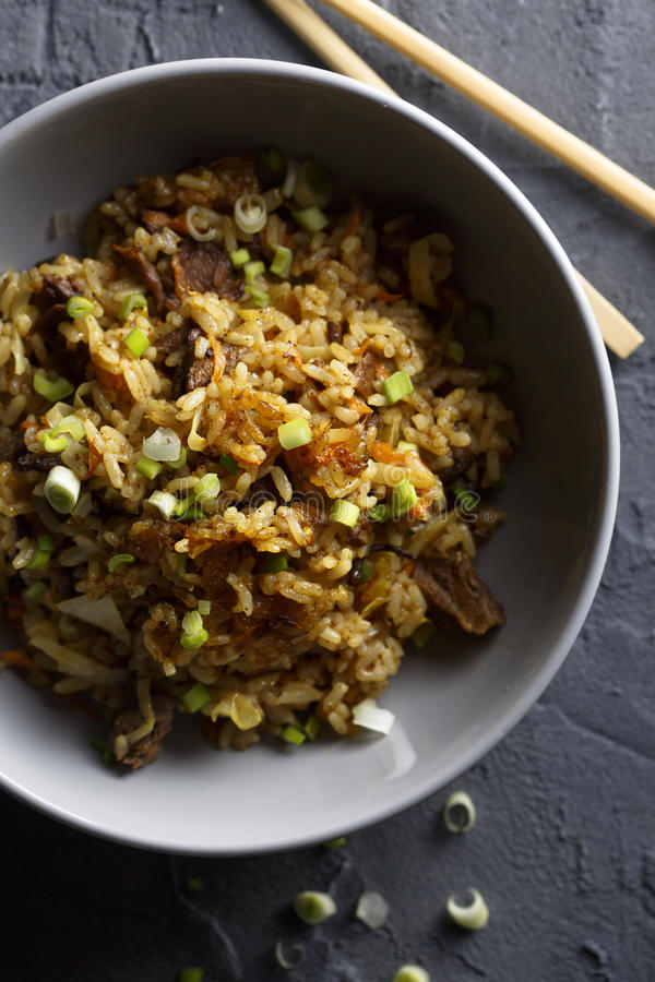 Fried rice with beef. And vegetables stock image