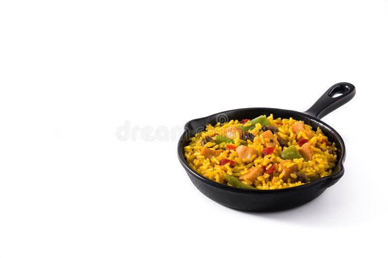 Fried rice with chicken and vegetables on frying iron pan isolated on white background royalty free stock image