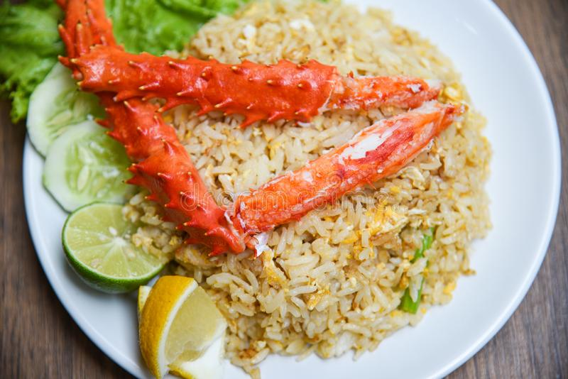 Fried Rice crab seafood / Healthy food fried rice with Crab legs with egg lemon stock images