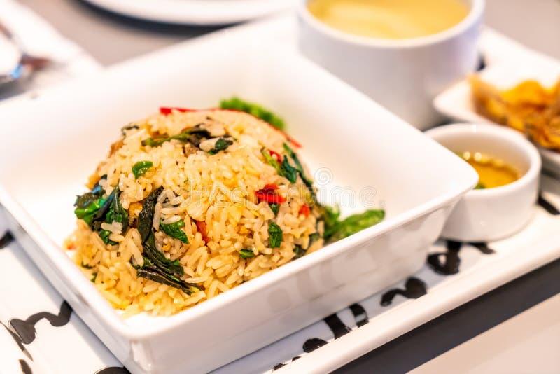 fried rice with crispy fish stock photos