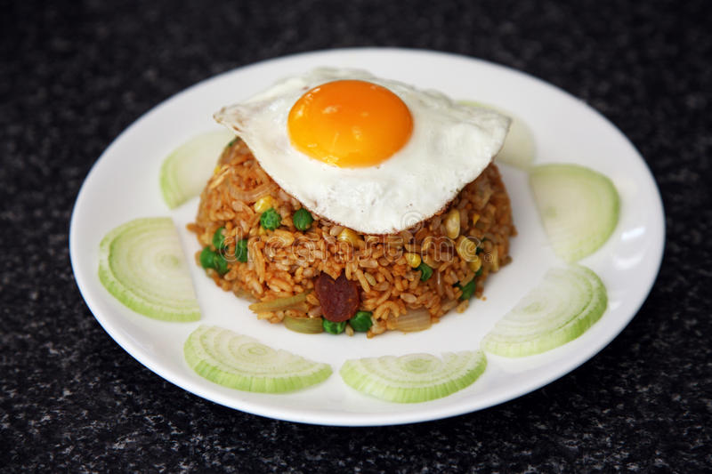 Fried rice with egg. On a plate royalty free stock image