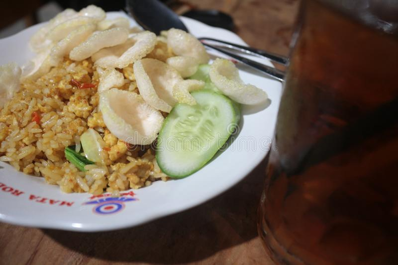 Fried rice and iced tea very good. Fried rice is a favorite food for all people royalty free stock image