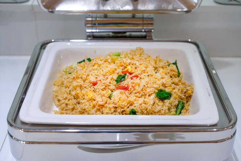 Fried rice in large white square bowl at Thailand resort stock image
