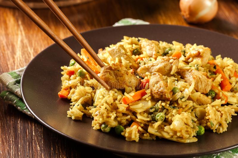 Fried rice nasi goreng with chicken and vegetables on a plate royalty free stock images