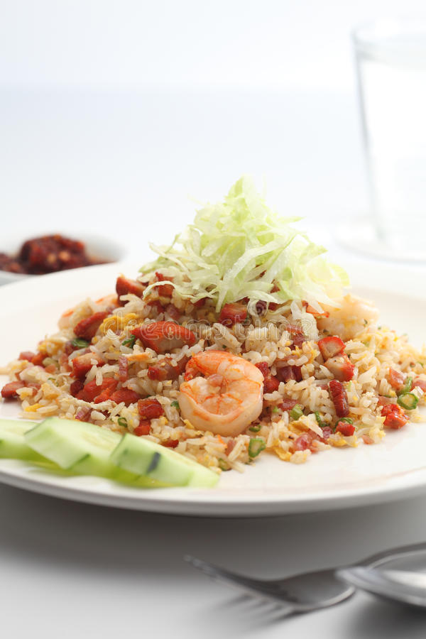 Fried rice. A plate of Chinese BBQ pork fried rice royalty free stock image