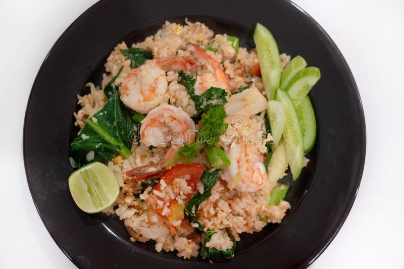 Fried rice with prawn herbs and vegetables served with lemon and royalty free stock photography