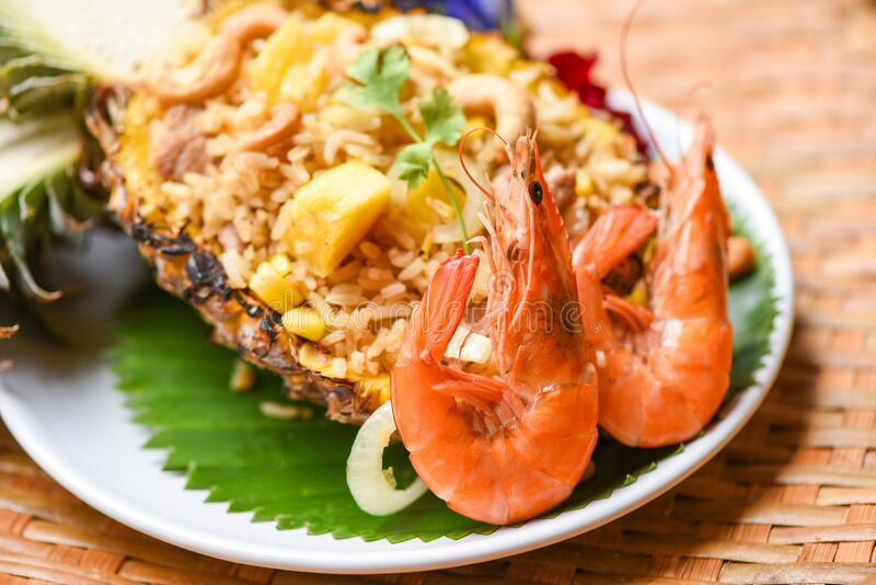 Fried rice shrimp and fruits pineapple on plate asian food in thai - delicious menu shrimps prawns cooked stock photography