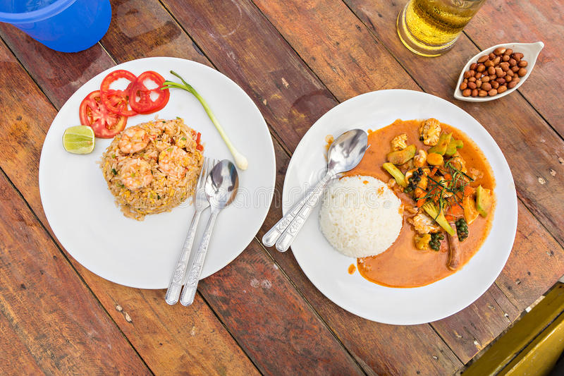 Fried rice with shrimp and Spicy fried squid with red curry. Thai food royalty free stock photography
