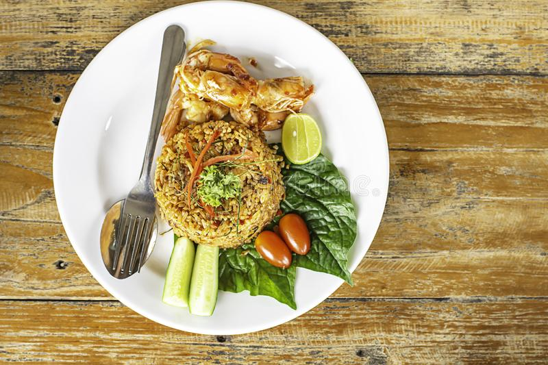 Fried rice with Shrimp on wooden table , spicy food Thai style royalty free stock images