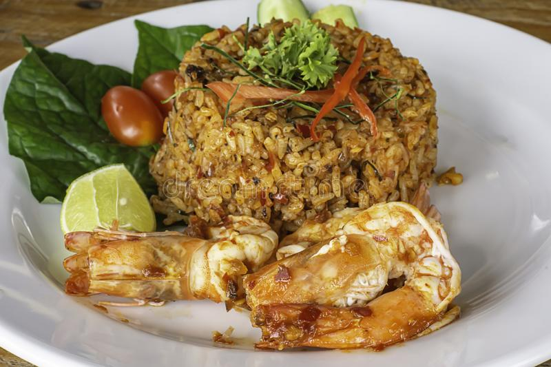 Fried rice with Shrimp on wooden table , spicy food Thai style stock photo