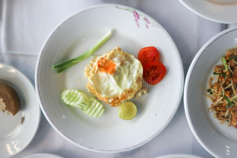 Fried rice or stir-fried rice with fried egg. And cucumber royalty free stock photos