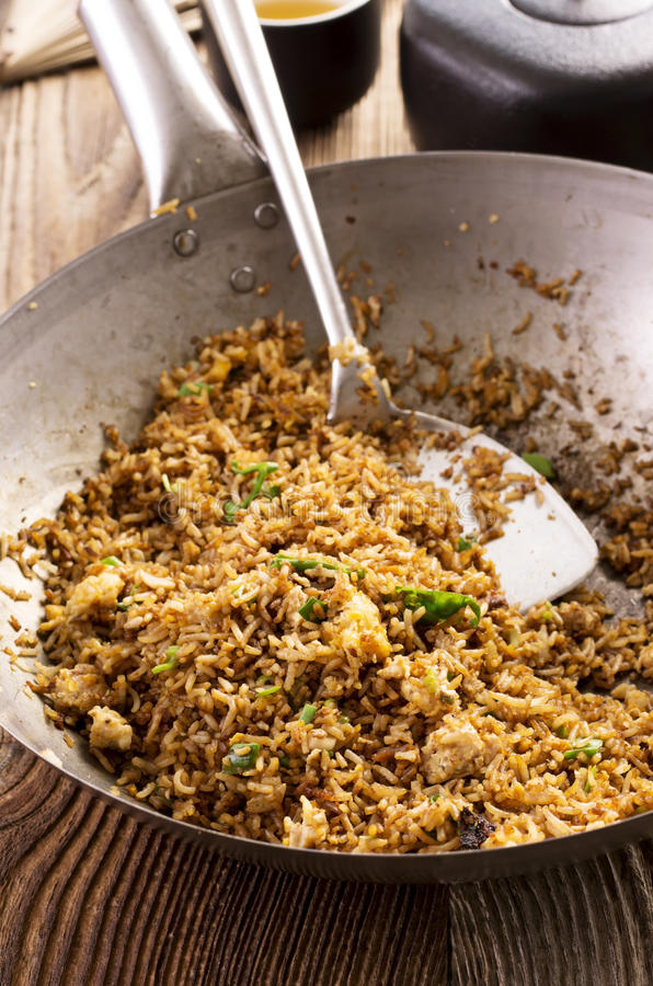 Fried Rice in Wok. Fried rice as closeup in a wok royalty free stock photo