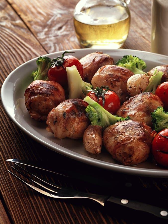 Fried rolls of turkey with broccoli. stock photos