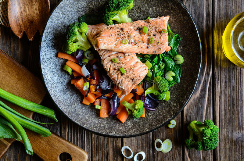Fried salmon with steamed vegetable royalty free stock photos