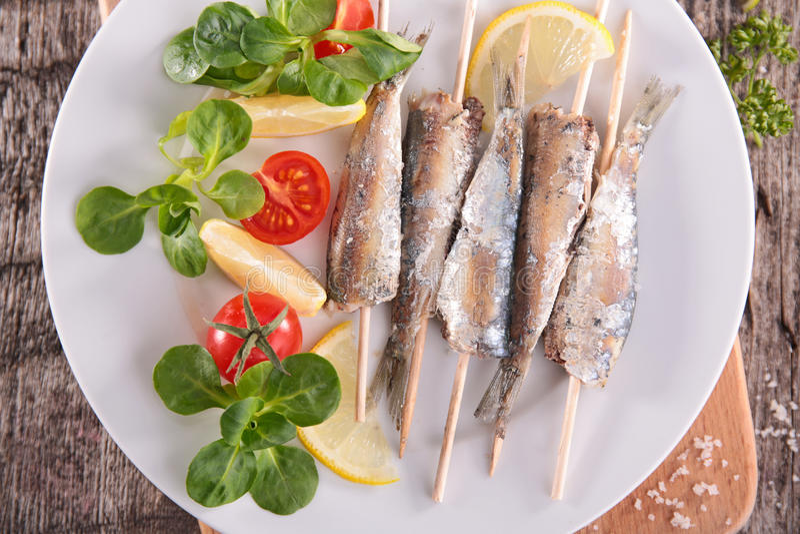 Fried sardine. Close up on fried sardine stock images
