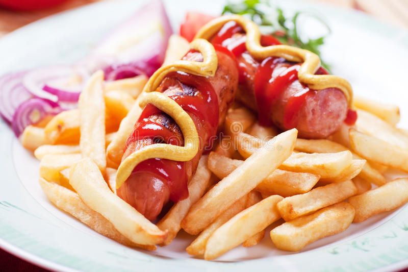 Fried Sausage With French Fries Stock Photos