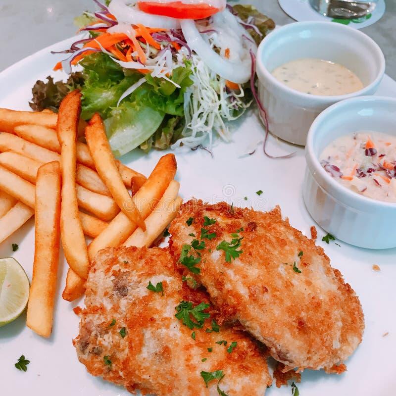 Fried sea bass steak. Fried sea bass or snapper fish steak stock image