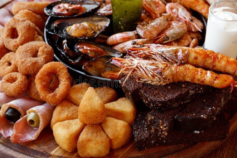 Fried Seafood platter closeup. Seafood platter. Mediterranean cuisine restaurant food closeup, fried calamari rings, king prawns, mussels, oysters, shellfish stock image