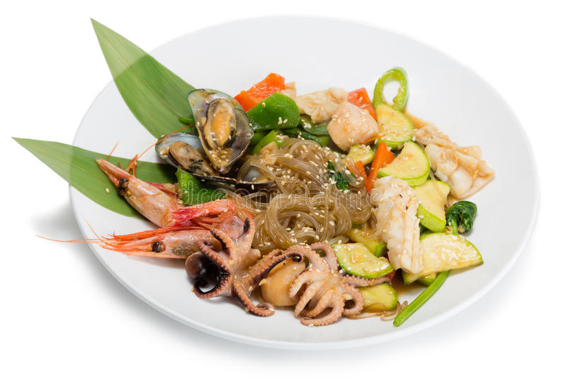Fried seafood with vegetables and rice noodles royalty free stock image
