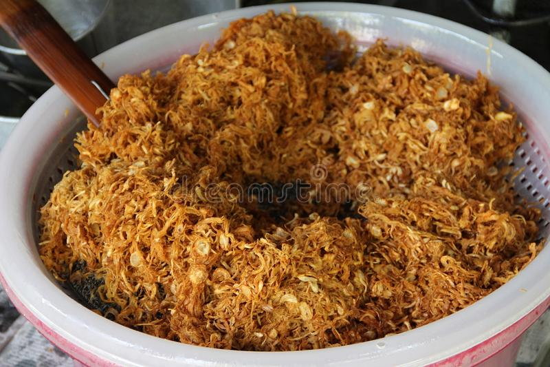 Fried shredded pork in process stock image