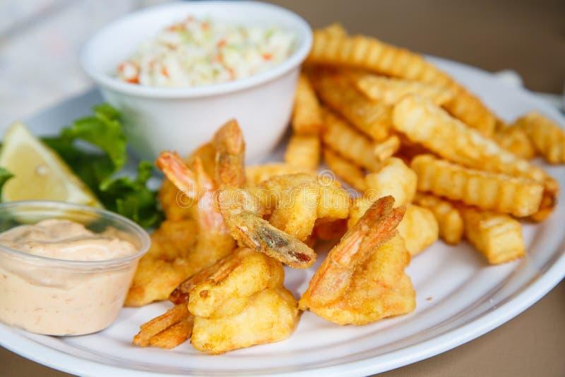 Fried Shrimp e patate fotografie stock
