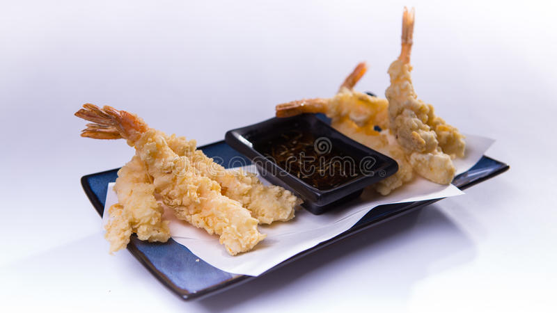 Fried shrimp tempura on blue chinese plate on white background royalty free stock photos