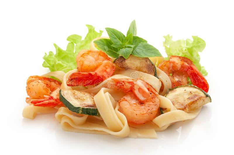 Fried shrimps with cabbage and pasta stock image