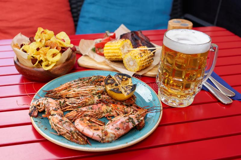 Fried shrimps and other Cajun style food stock image