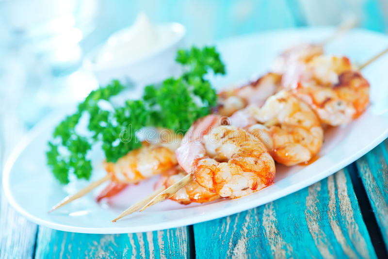 Fried shrimps. On white plate and on a table stock photography