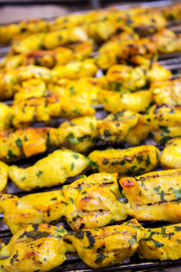 Fried skewers on the grill. Skewers of chicken fried on a grill royalty free stock image