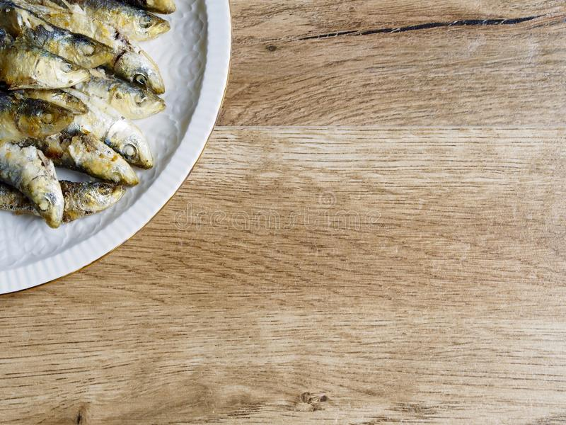 Fried small sardine on a plate royalty free stock photo