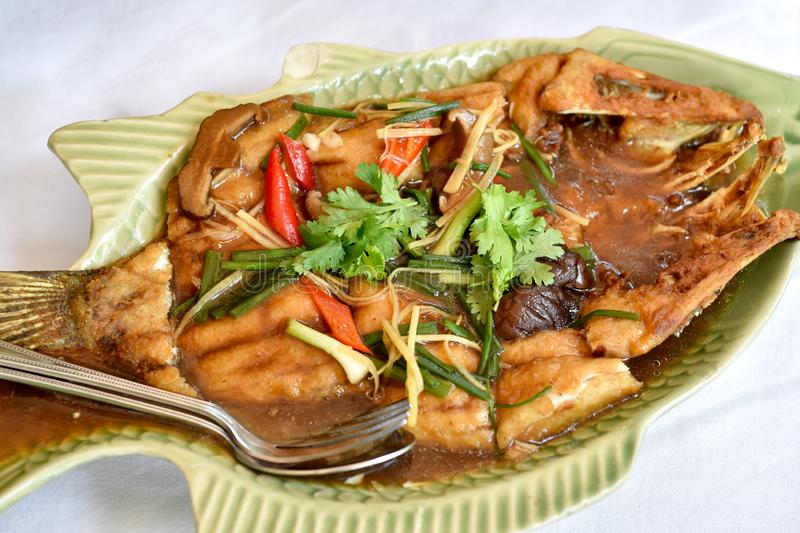 Fried snapper fish, Fish steamed in soy sauce, Traditional Chinese cooking style. stock photos